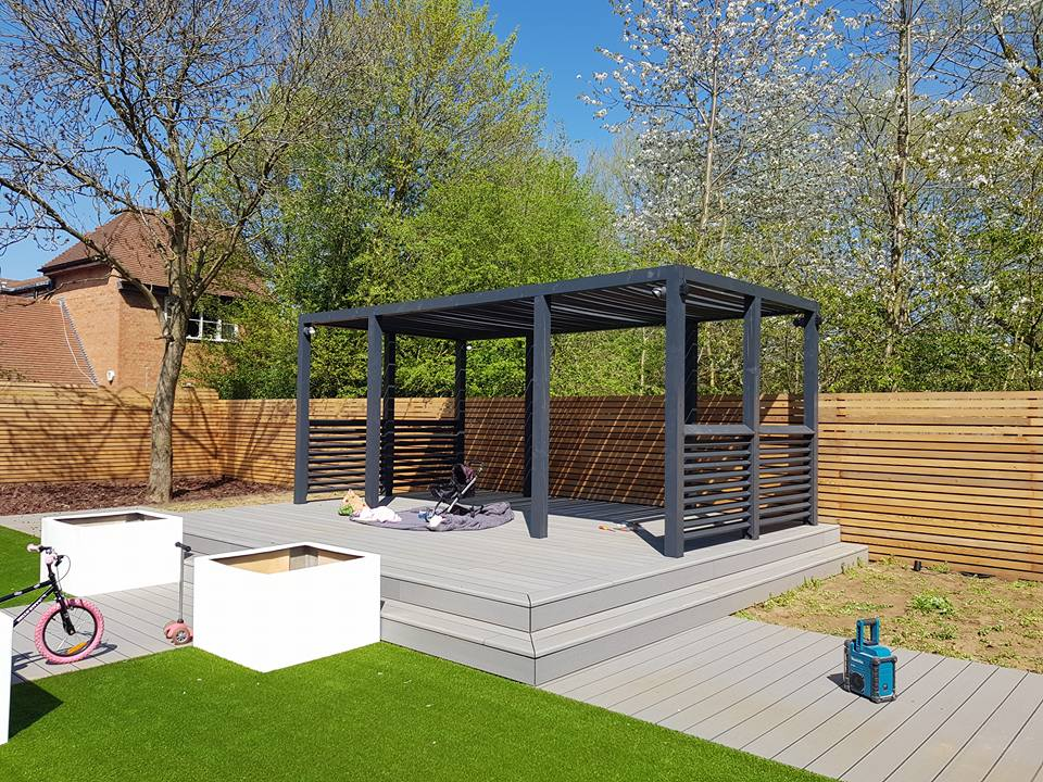 Garden pergola on grey decking